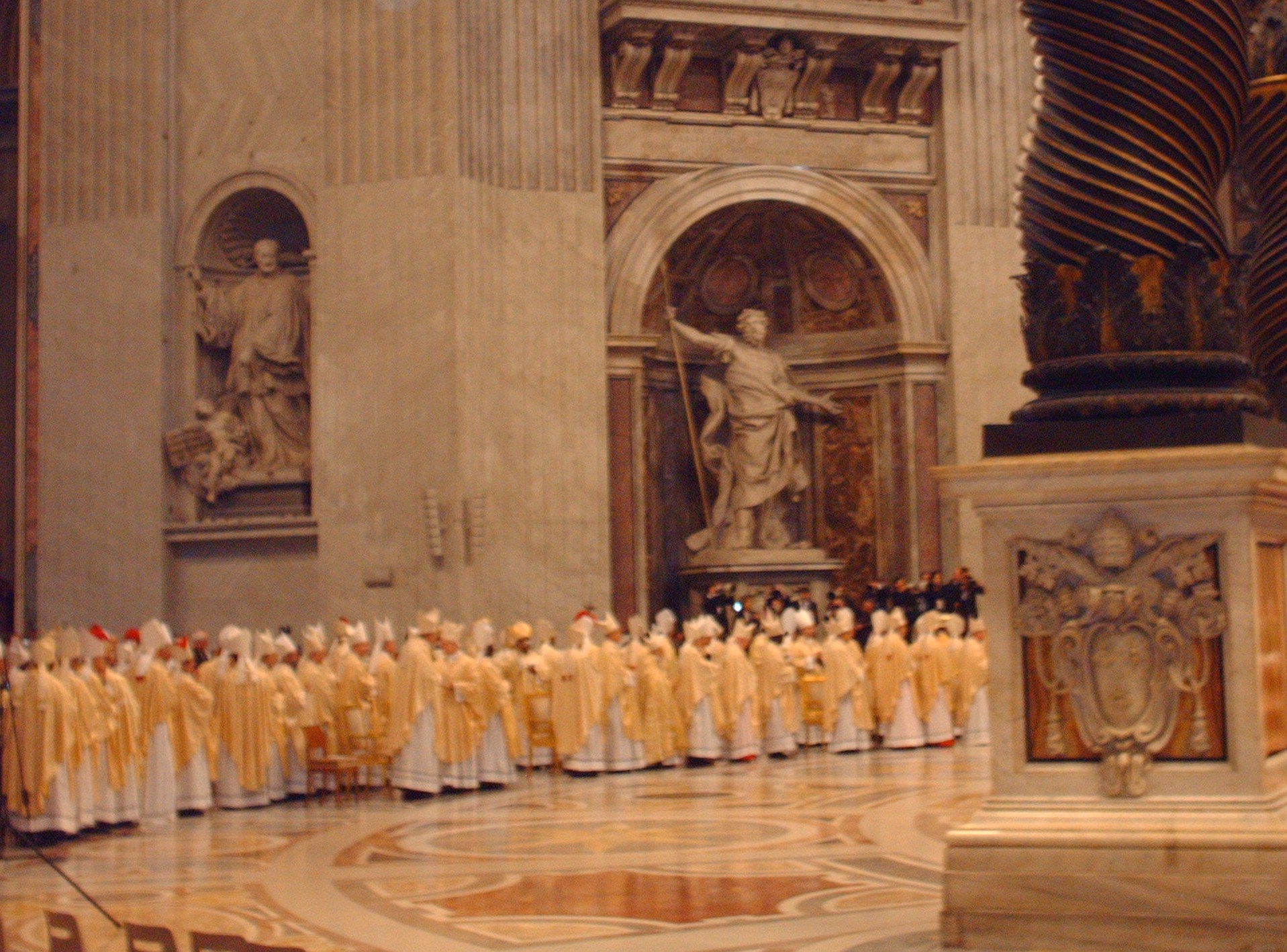 Bishops file out of St. Peter's Basilica as the Synod of Bishops concludes.