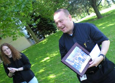 Fr. Bob Meyer receiving gift