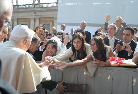 Pope Benedict XVI with newlyweds at the General Audience