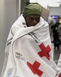 A Canadian evacuee from Haiti arrives at Trudeau International Airport in Montreal Jan. 15. The death toll in Haiti's catastrophic earthquake could run to tens of thousands of people. An estimated 3 million others will require emergency assistance, according to aid groups. (CNS photo/Christinne Muschi, Reuters) (Jan. 15, 2010) See stories slugged HAITI- Jan. 15, 2010.