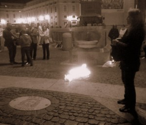 A cross of tea lights in St. Peter's Square on Good Friday.