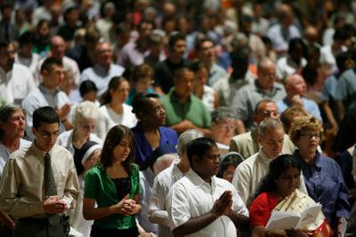 CATHOLICS PRAY DURING MASS ON FEAST OF ASSUMPTION