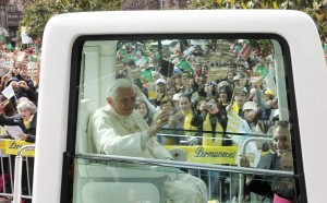 Pope Benedict XVI arrives in the popemobile at Avenida dos Aliados square to celebrate an outdoor Mass in Porto, northern Portugal. CNS Photo