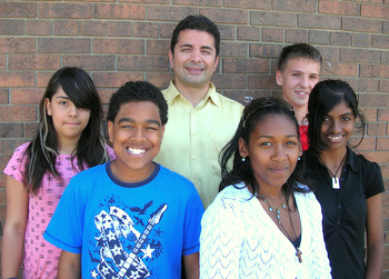 Principal Mark Cassar with students of Holy Cross Catholic School
