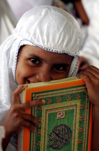 ACHENESE GIRL HOLDS COPY OF QURAN