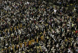 Exuberant faithful wave white scarves in celebration of Brother André's canonization. (Photo: VU)