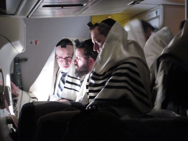 Image result for orthodox jews praying on a plane