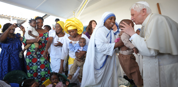 POPE BENEDICT KISSES CHILD DURING VISIT TO PARISH IN BENIN