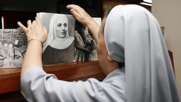 Nun looks at image of Blessed Mother Laura Montoya in 2012 in Medellin