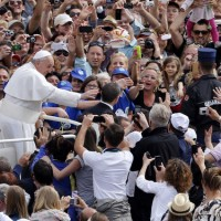 Pope Francis waves as he arrives for weekly audience in St. Peter&#039;s Square at Vatican