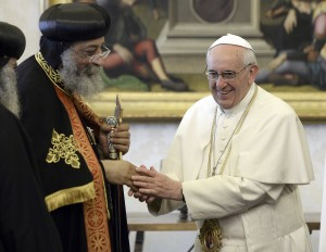Pope Francis shakes hand of Coptic Orthodox leader during private audience at Vatican