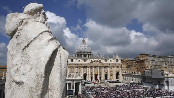 Large crowd gathers in St. Peter's Square during canonization Mass at Vatican