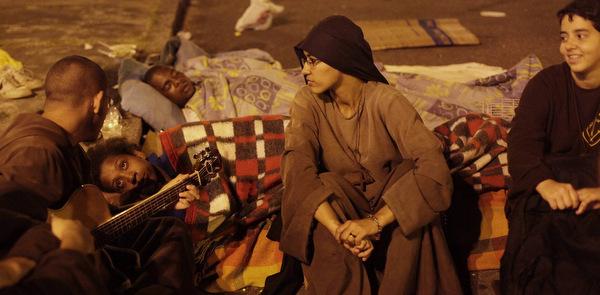 Members of the Franciscan community O Caminho comfort homeless in Rio de Janeiro