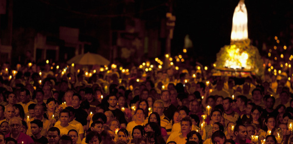 PILGRIMS PARTICIPATE IN CANDLELIGHT PROCESSION NEAR OUR LADY OF FATIMA SHRINE IN BRAZIL