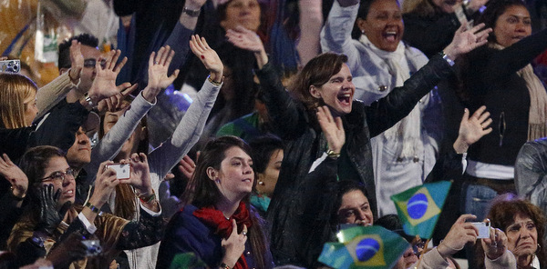 Pilgrims react as pope arrives for World Youth Day welcoming ceremony on Copacabana beach in Rio