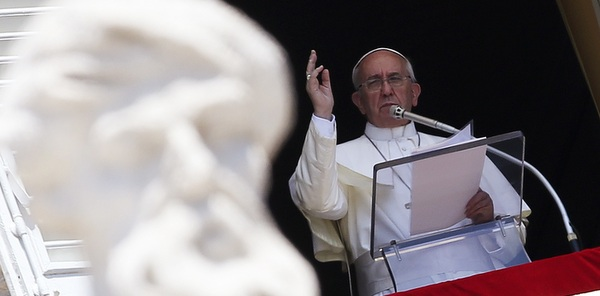 Pope gives blessing as he leads Angelus at Vatican