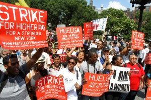 Fast-food workers and supporters demand higher wages during rally in New York