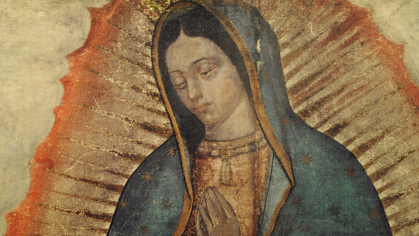 WOMAN LAYS HAND ON IMAGE OF OUR LADY OF GUADALUPE ON DISPLAY AT NEW YORK CATHOLIC CHURCH
