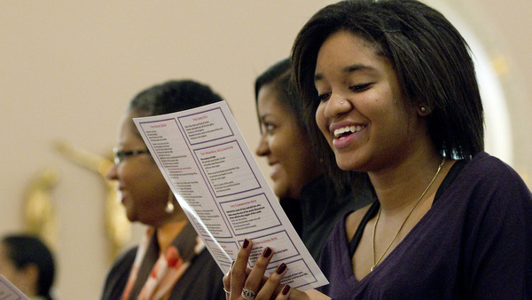 YOUNG WOMAN RECITES NEWLY WORDED RESPONSE DURING MASS AT VIRGINIA PARISH