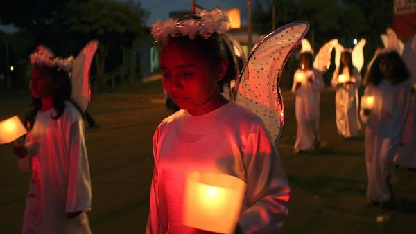CHILDREN DRESSED AS ANGELS TAKE PART IN CHRISTMAS FESTIVAL IN NICARAGUA