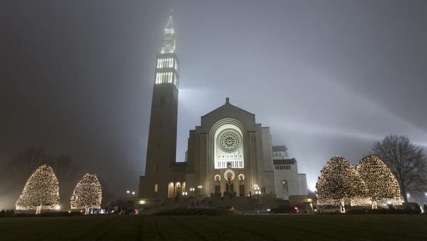 NATIONAL SHRINE ILLUMINATED ON FOGGY CHRISTMAS EVE IN WASHINGTON
