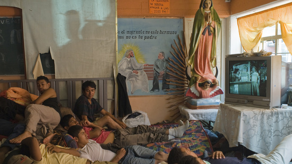 PEOPLE PACK ROOM AT CHURCH-RUN MIGRANT SHELTER OUTSIDE MEXICO CITY