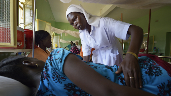 Nun comforts patient in South Sudan