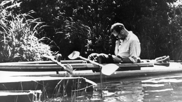 Father Karol Wojtyla reading in canoe in 1955
