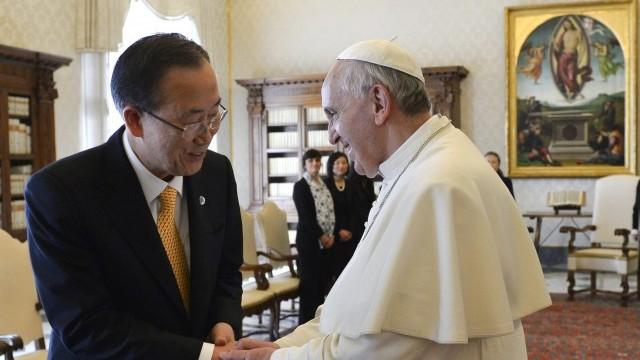 Pope Francis greets U.N. Secretary-General Ban Ki-moon during meeting at Vatican