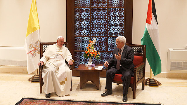 Pope Francis visits with Palestinian President Mahmoud Abbas after an arrival ceremony at the presidential palace in Bethlehem, West Bank, May 25. (CNS photo/Paul Haring)