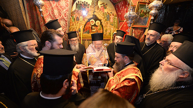 Ecumenical Patriarch Bartholomew of Constantinople prays during a visit to the Church of the Nativity in Bethlehem. (CNS photo/courtesy John Mindala)