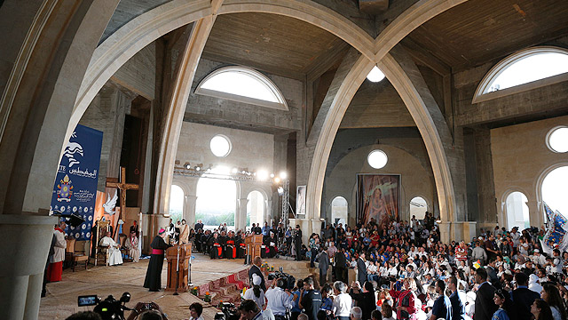 Pope Francis meets with refugees and disabled young people in the Latin church at Bethany Beyond the Jordan, the traditional site of Jesus' baptism, southwest of Amman, Jordan, May 24. (CNS photo/Paul Haring)