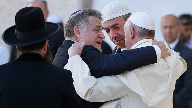 "Pope Francis is embraced by Argentine Rabbi Abraham Skorka as he leaves after praying at the Western Wall in Jerusalem May 26. On the right is Omar Abboud, Muslim leader from Argentina. ""We did it,"" Rabbi Skorka said he told the pope and Abboud. The pope 's message contained the text of the Our Father and of the 122nd Psalm, traditionally prayed by Jewish pilgrims who travel to Jerusalem.(CNS photo/Paul Haring) (May 26, 2014) (CNS photo/Paul Haring)"