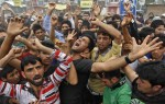 Kashmiri Shiite Muslims in India shout religious slogans as they take part in a protest against ongoing conflict in Iraq