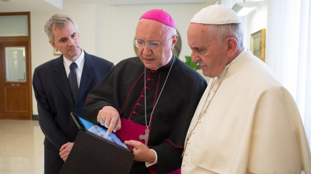 Pope being presented with Pope App
