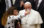 Woman takes selfie with Pope Francis during weekly audience in Paul VI hall at the Vatican