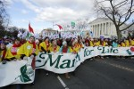 March for Life participants carry banner past front of  U.S. Supreme Court building in Washington