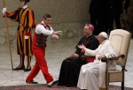 Circus artist presents balls to Pope Francis during general audience in Paul VI hall at Vatican