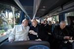 Pope Francis talks with Cardinal Bertone as they leave Lenten spiritual retreat in Ariccia, near Rome