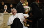 Nuns greet Pope Francis during meeting with religious at cathedral in Naples