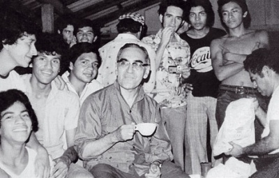 Romero with young men