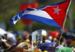 PERSON WAVES CUBAN FLAG AS CROWD GATHERS FOR MASS WITH POPE IN HAVANA