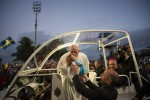 Pope kisses infant during World Youth Day in Rio de Janeiro