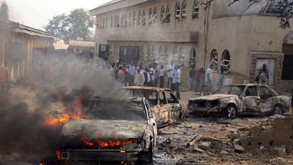 CAR BURNS AT SITE OF EXPLOSION AT CATHOLIC CHURCH IN NIGERIA