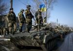 Ukrainian armed forces ride on armored personnel carriers near Debaltseve, Ukraine, Feb. 12. (CNS photo/Gleb Garanich, Reuters) See UKRAINE-PRAYERS Feb. 12, 2015.