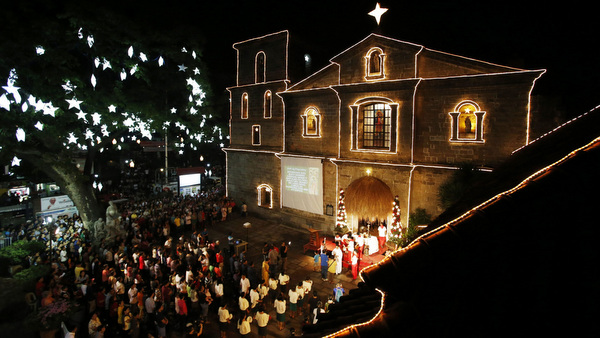 """Devotees take part in the first of a nine-day pre-dawn Mass, locally called """"Misa de Gallo,"""" before Christmas at a church in Manila, Philippines, Dec. 16. The pre-dawn Mass is one of the most popular traditions among Filipinos during the Christmas season. (CNS photo/Erik De Castro, Reuters)"""