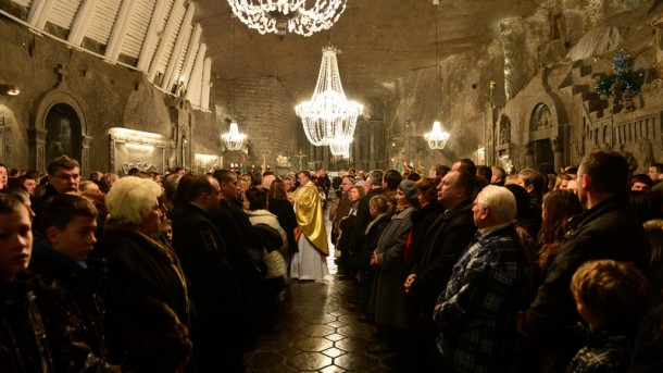 In this Dec. 24, 2013 file photo, Polish miners and their families gather for Christmas Eve Mass at the Wieliczka Salt Mine. (CNS photo/Jacek Bednarczyk, EPA) See WYD-FRANCIS May 28, 2015.