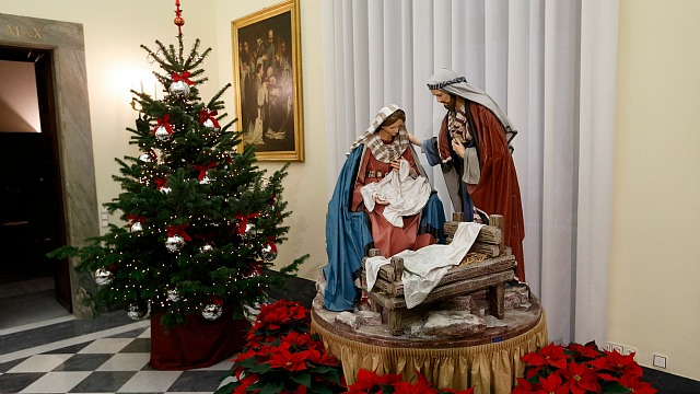 A Nativity scene and Christmas tree decorate the Apostolic Palace at the Vatican Dec. 15. (CNS photo/Paul Haring)