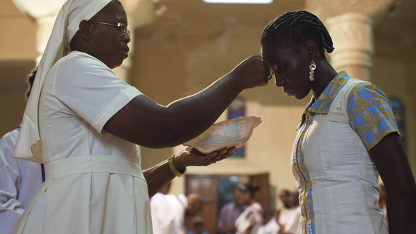 Nun distributes ashes during Ash Wednesday Mass at cathedral in Mali
