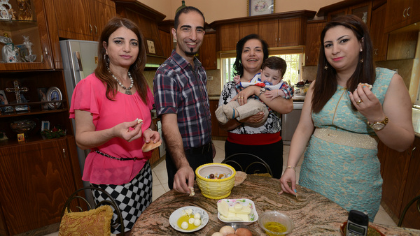 Catholic mother in West Bank breaks the Lenten fast with her husband's Greek Orthodox family